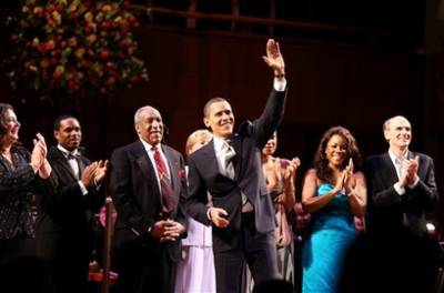 President Obama surprised the audience when he joined entertainers onstage to sing Happy Birthday to Senator Kennedy who attended with his wife Victoria.