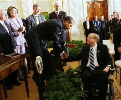 Obama shakes hands with representative Jim Langevin. President Barack Obama reverses the Bush administration policies on stem cell research and signs an Executive Order providing wider scientific use and federal funding of embryonic stem cell research opening a new scientific front free of political ideology.
