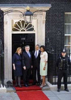President Barack Obama and First Lady Michelle Obama are greeted by UK PM Gordon Brown and his wife Sarah at 10 Downing Street.