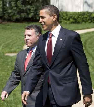 President Barack Obama walks King Abdullah II of Jordan to his limousine after meetings in the White House.