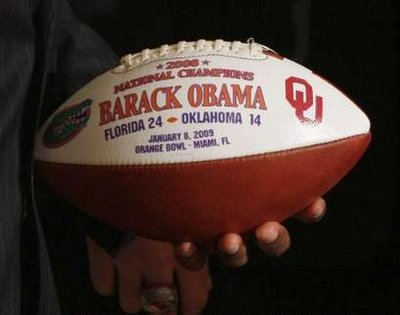 The Gators football team presented President Obama with a Championship football and a personalized team jersey.