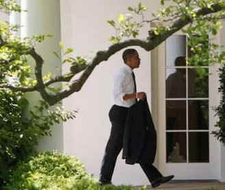 After greeting guests at the ceremony President Obama,  followed by White House aides, walked across the South Lawn to the Oval Office.