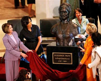 First Lady Michelle Obama, Secretary of State Hillary Clinton, Speaker of the House Nancy Pelosi and other guests join in an unveiling ceremony of the sculpted bust of Sojourner Truth.