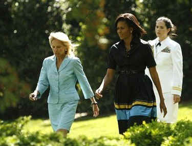 First Lady Michelle Obama and Second Lady Jill Biden arrive at the award ceremony.