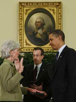 President Barack Obama joins the swearing in ceremony of Kathleen Sebelius as the new Secretary of Health and Human Services in the Oval Office of the White House on April 28, 2009.