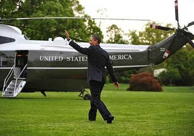 President Barack Obama walks across the South Lawn of the White House to board Marine One.