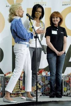 First Lady Michelle Obama and Second Lady Jill Biden join spouses of Members of Congress and other volunteers at a Capital Area Food Bank.