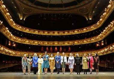 First Lady Michelle Obama joins Sarah Brown, the wife of UK PM Brown, and other spouses of G20 leaders at a special performance of Giselle at the Royal Opera House in London on April 2, 2009.