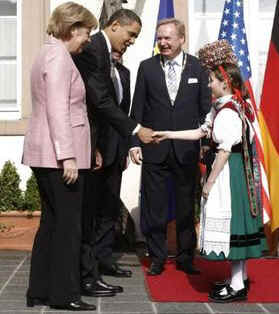 President Obama is greeted by Baden-Baden Mayor Wolfgang Gerstner, and young Germans dressed in traditional Black Forest area dress.