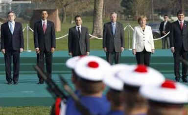 President Barack Obama and NATO leaders participate in a NATO Military Ceremony and a moment of silence for fallen NATO soldiers in Strasbourg, France on April 4, 2009.