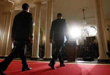 President Barack Obama, US Treasury Secretary Timothy Geithner, and Internal Revenue Service (IRS) Commissioner Doug Shulman arrive to remark on tax reform in the Grand Foyer of the White House on May 4, 2009.