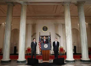 President Barack Obama, US Treasury Secretary Timothy Geithner, and Internal Revenue Service (IRS) Commissioner Doug Shulman remark on tax reform in the Grand Foyer of the White House on May 4, 2009.