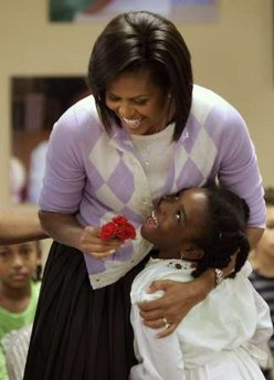 First Lady Michelle Obama celebrates Cinco de Mayo, an Hispanic heritage event, in a celebration with students at Lamb Public Charter School in Washington on May 4, 2009.