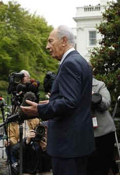 After meeting with President Obama, Israeli President Peres talks to reporters assembled outside the West Wing of the White House.