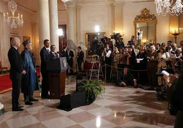 President Barack Obama speaks to the media in the Grand Foyer of the White House after trilateral meetings.
