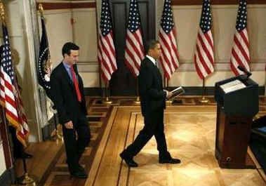 President Barack Obama arrives to deliver remarks on reducing spending in the budget with Budget Director Peter Orzag.