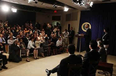 President Barack Obama makes an unannounced visit to a Spanish language Town Hall meeting in the Eisenhower Executive Office Building on May 8, 2009.