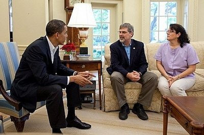 President Obama meets with Captain Richard Phillips and his wife Andrea in the oval Office of the White House.