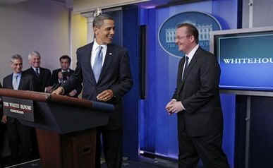 President Barack Obama interrupts the press briefing by Press Secretary Robert Gibbs in the Brady Press Briefing Room.