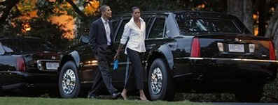 President Barack Obama and First Lady Michelle Obama return to the White House in the presidential limo.